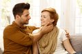 Loving couple embracing attractive young at home smiling Royalty Free Stock Photography