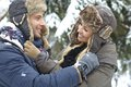 Loving couple embracing at winter outdoor photo of wintertime smiling happy Stock Image