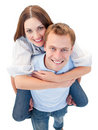 Loving couple enjoying piggyback ride Royalty Free Stock Photos