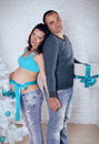 Loving couple family embracing with pregnant belly Stock Photography