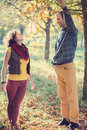 Loving couple having fun in autumnal park bright clothes walking together and Stock Image