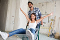 Loving couple is having fun while they are renovating house