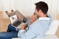 Loving couple having online video conference at home Royalty Free Stock Photo