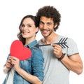 Loving Couple Holding Arrow And Heart Royalty Free Stock Photo