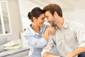 Loving couple at home looking at each other cute s eyes Royalty Free Stock Image