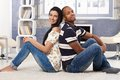 Loving couple at home smiling Stock Images