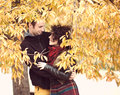 Loving couple hugging in autumnal park bright clothes Royalty Free Stock Image
