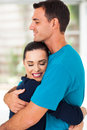 Loving couple hugging enjoying precious moment Stock Photos