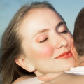 Loving couple hugging with focus on woman's face Royalty Free Stock Photo
