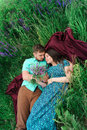 Loving couple lie together on a meadow. Royalty Free Stock Photo