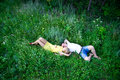 Loving couple lying on green grass Royalty Free Stock Photo