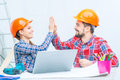 Loving couple preparing for renovation we are one team pleasant cheerful making project of their future house while giving five Stock Photography