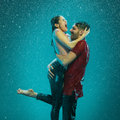 The loving couple in the rain Royalty Free Stock Photo