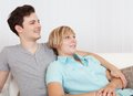Loving couple relaxing on a sofa Royalty Free Stock Photo