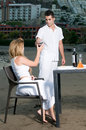 Loving couple at a romantic dinner in the beach Royalty Free Stock Photography