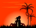 Loving couple silhouetted at sunset Stock Image