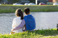 The loving couple is sitting on the grass. Royalty Free Stock Photo