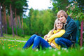 image photo : Loving couple are sitting in the sunny park