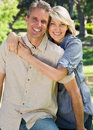 Loving couple spending time together in park portrait of happy Royalty Free Stock Photography