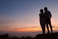 Loving couple sunset silhouette