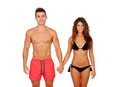 Loving couple in swimwear isolated on white background Royalty Free Stock Image