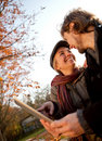 Loving couple with a tablet Royalty Free Stock Image