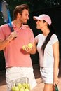 Loving couple on tennis court smiling Stock Images
