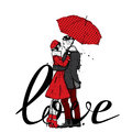 Loving couple under an umbrella. Beautiful guy and the girl in fashionable clothes. Fash