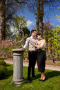 Loving couple in Victorian clothing, column and su Royalty Free Stock Photo