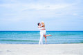 Loving couple walking and embracing on a summer beach Royalty Free Stock Photo