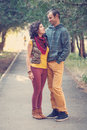 Loving couple walking and hugging in the park bright clothes together Royalty Free Stock Photography