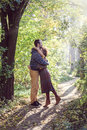 Loving couple walking and hugging in the park bright clothes together Stock Photography
