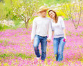 Loving couple walking in spring park young walk first love romantic date springtime holidays spending time together outdoors Stock Photos