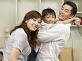 Loving family asian having fun at home Stock Images