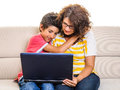 Loving family laptop computer boy and mother looking at pc sitting on sofa at home isolated Royalty Free Stock Photos