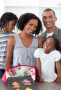 Loving family showing handmade cookies Stock Photography