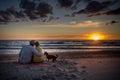 Loving family at sunset sea Royalty Free Stock Photo
