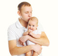 Loving father hugging and kissing baby on white Royalty Free Stock Photo