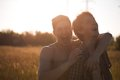 Loving gay couple in field Royalty Free Stock Photography