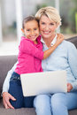 Loving granddaughter grandmother little hugging at home Royalty Free Stock Photography