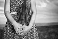 In loving hands violinist holds her violin a field at duck Royalty Free Stock Image