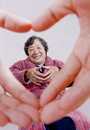 Loving heart and the elderly Royalty Free Stock Image