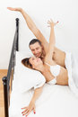 Loving man and woman awaking together on bed middle aged men women in home Royalty Free Stock Images