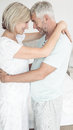Loving mature couple with arms around side view of a at home Royalty Free Stock Photography
