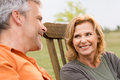 Loving mature couple close up of smiling woman looking her husband Stock Photos