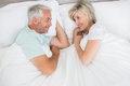 Loving mature couple lying in bed men and women at the home Royalty Free Stock Photo