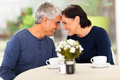 Loving mature couple spend time together at home Stock Images