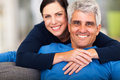 Loving middle aged couple happy relaxing at home Royalty Free Stock Photography