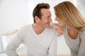 Loving middle aged couple looking at eachother lovely year old home Stock Photo