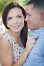 Loving mixed race couple portrait in the park happy romantic Stock Photos